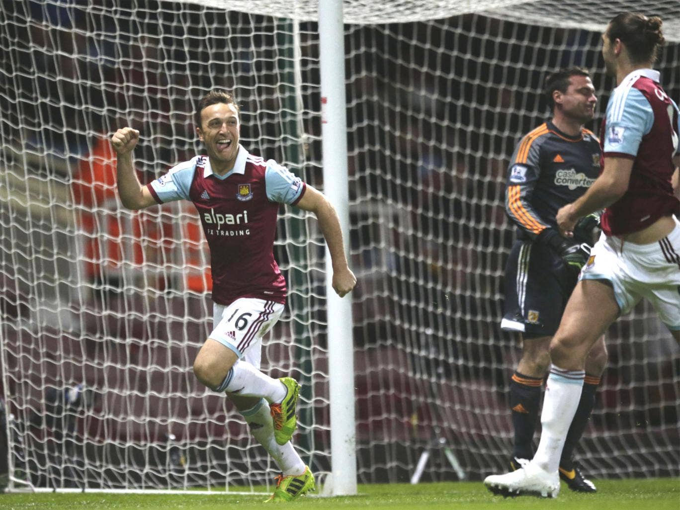Mark Noble celebrates after demonstrating his trademark coolness from the penalty spot
