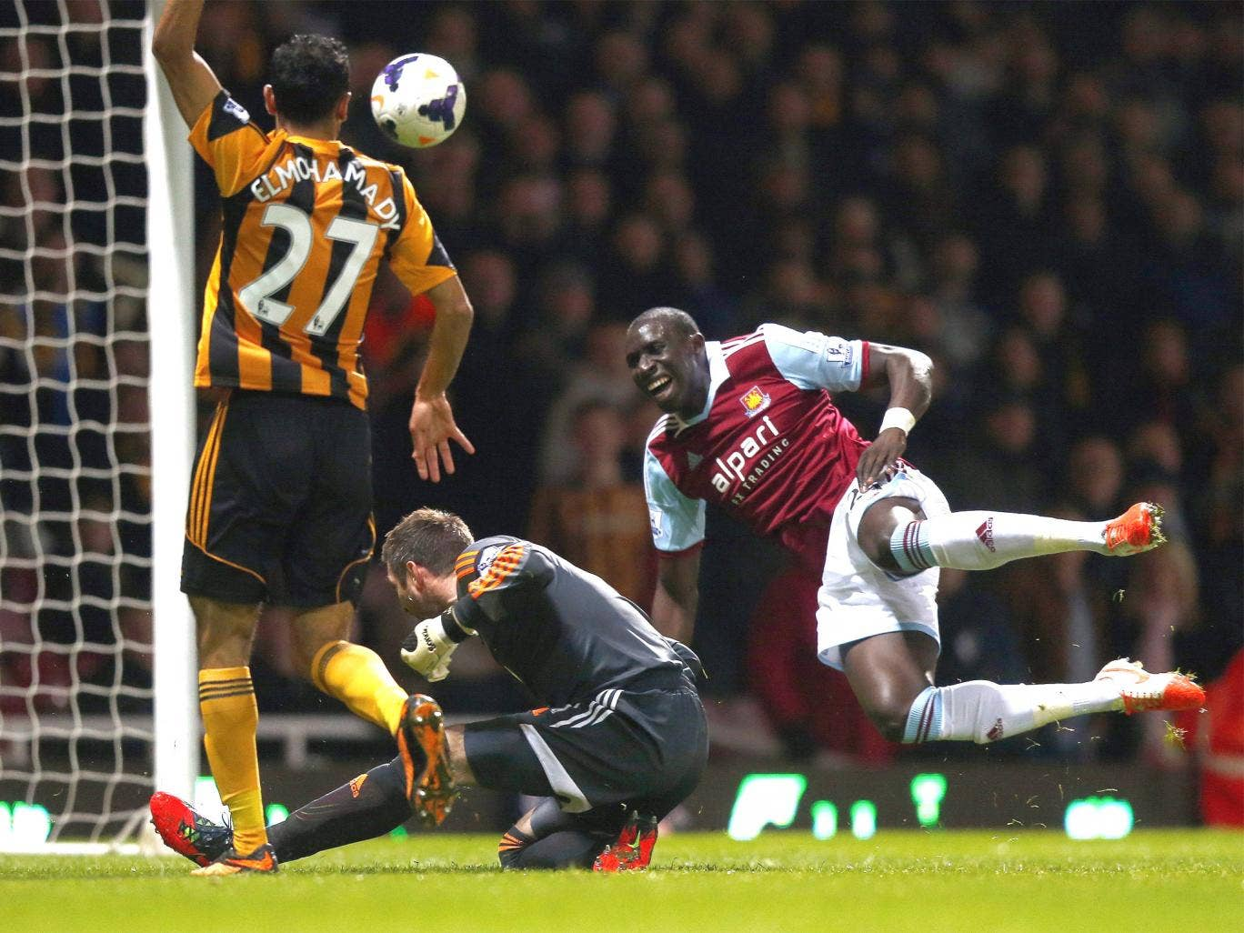 Mohamed Diamé is fouled by Hull keeper Allan McGregor, who was sent off