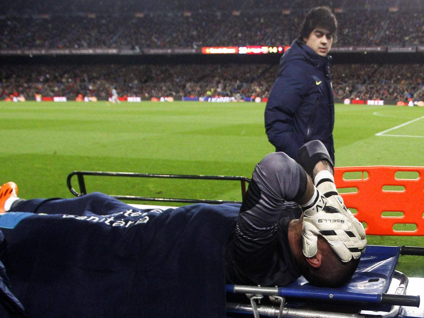 Victor Valdes holds his head in his hands after picking up a serious knee injury while playing for Barcelona