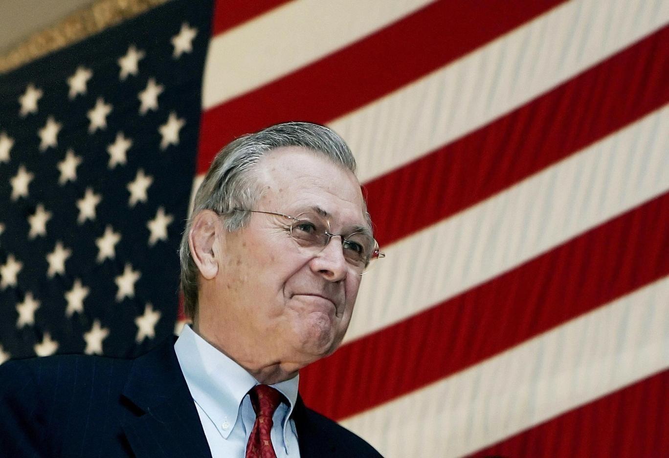 Donald Rumsfeld arrives on stage to address troops in Bagram, Afghanistan in 2005