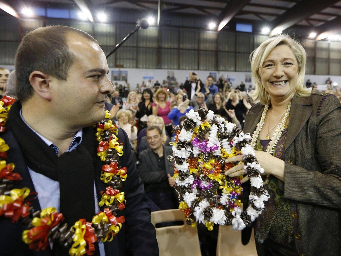 The National Front president Marine Le Pen and David Rachline, the party's candidate for tomorrow's mayoral elections in Fréjus, at a campaign meeting earlier this month