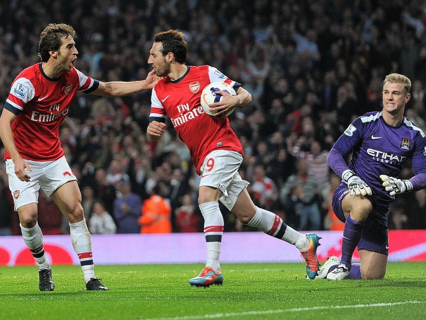 Mathieu Flamini and Santi Cazorla celebrate the former's goal for Arsenal