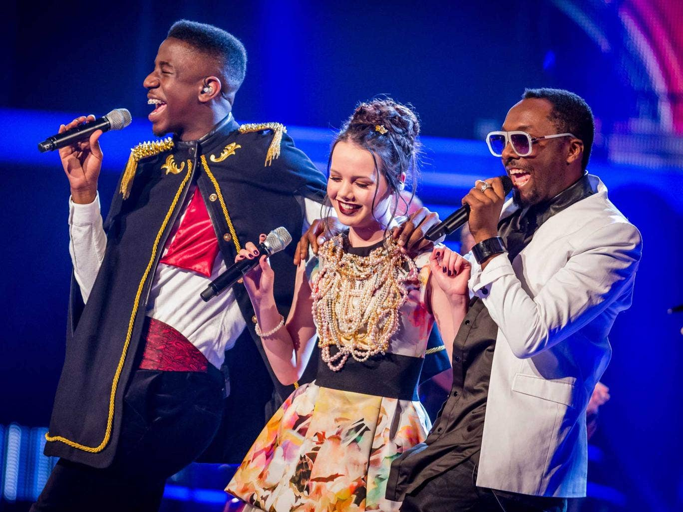 Will.i.am singing with Jermaine Jackman and Sophie May Williams