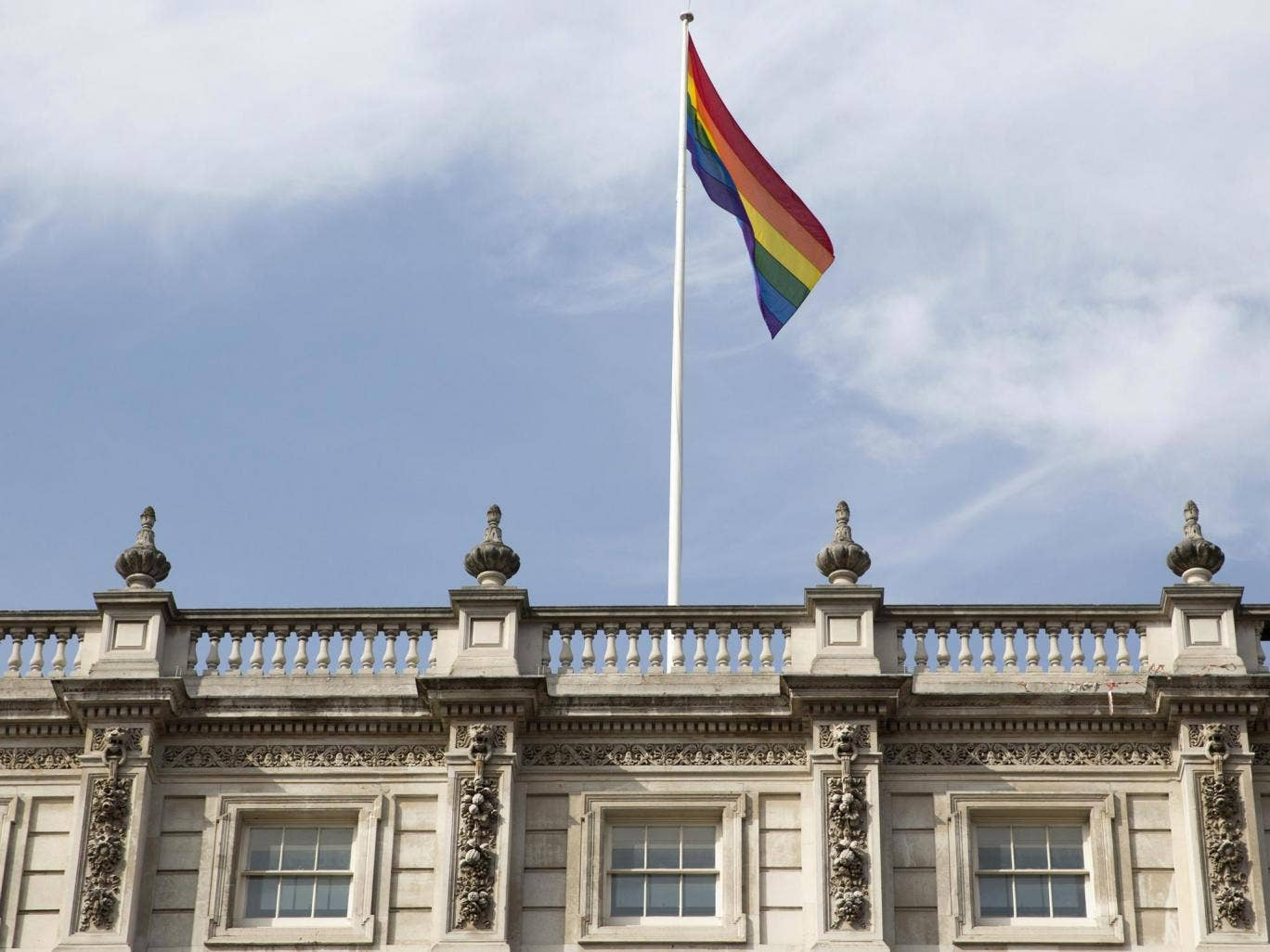 The rainbow flag flies above British Cabinet Offices, marking the first day Britain has allowed same sex marriages, in London