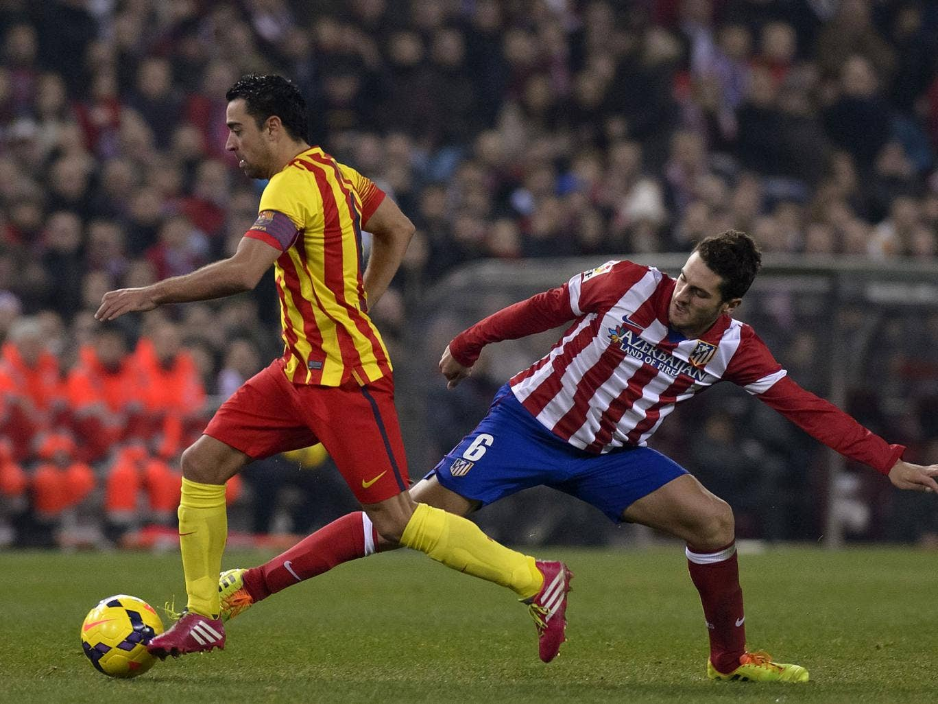 Xavi (left) and Koke vie for the ball during Barcelona's 0-0 La Liga draw at Atletico Madrid in January