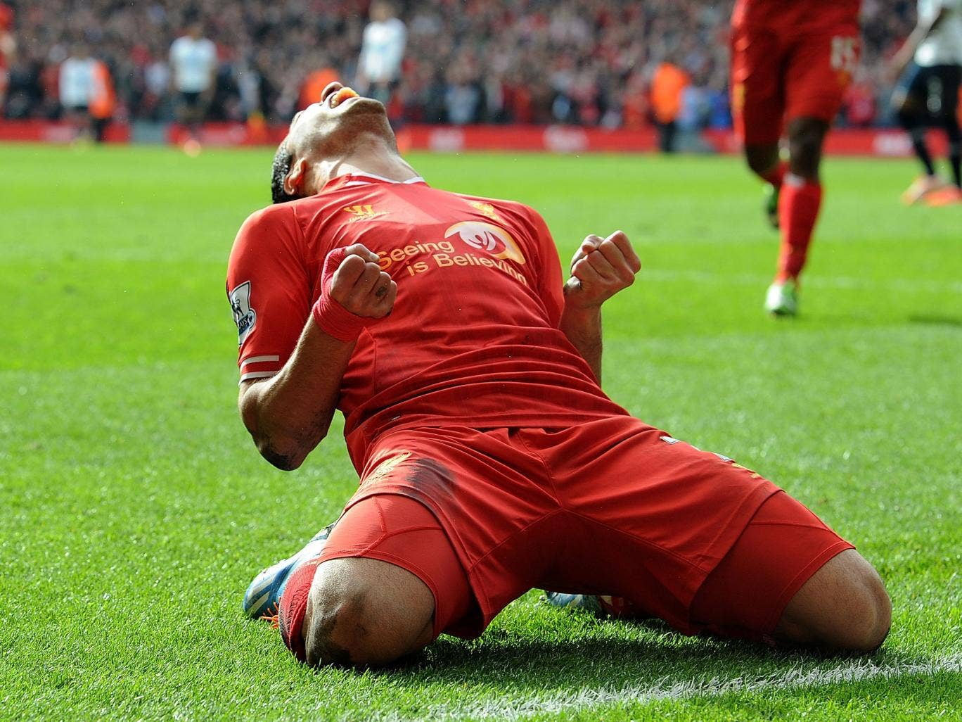 Luis Suarez of Liverpool celebrates the second goal against Tottenham
