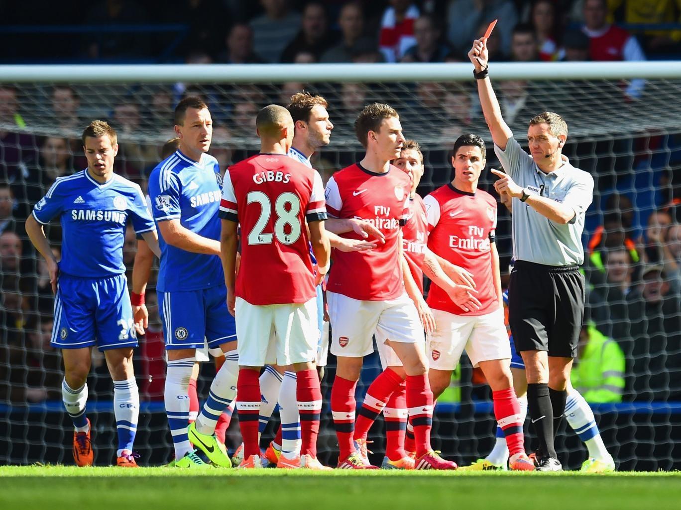 Andre Marriner sends off Arsenal's Kieran Gibbs last week in a case of mistaken identity