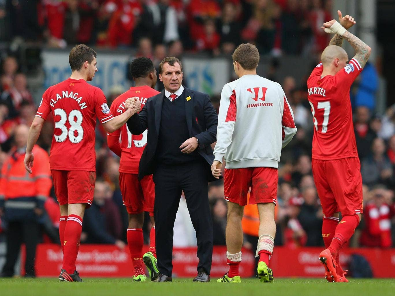 Brendan Rodgers celebrates Liverpool's 4-0 victory over Tottenham with his players