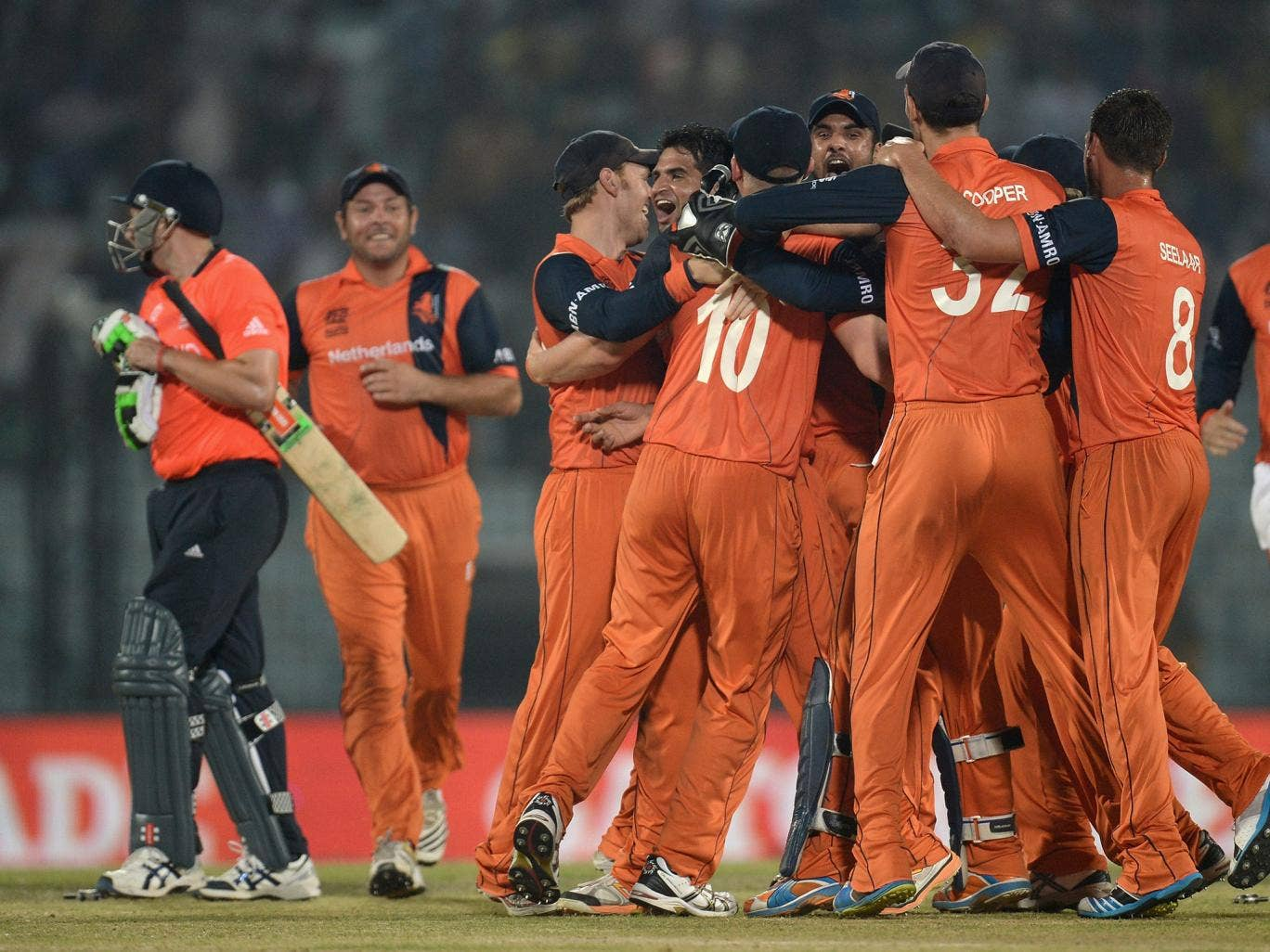Netherlands players celebrate the final wicket of James Tredwell of England to win the ICC World Twenty20 match