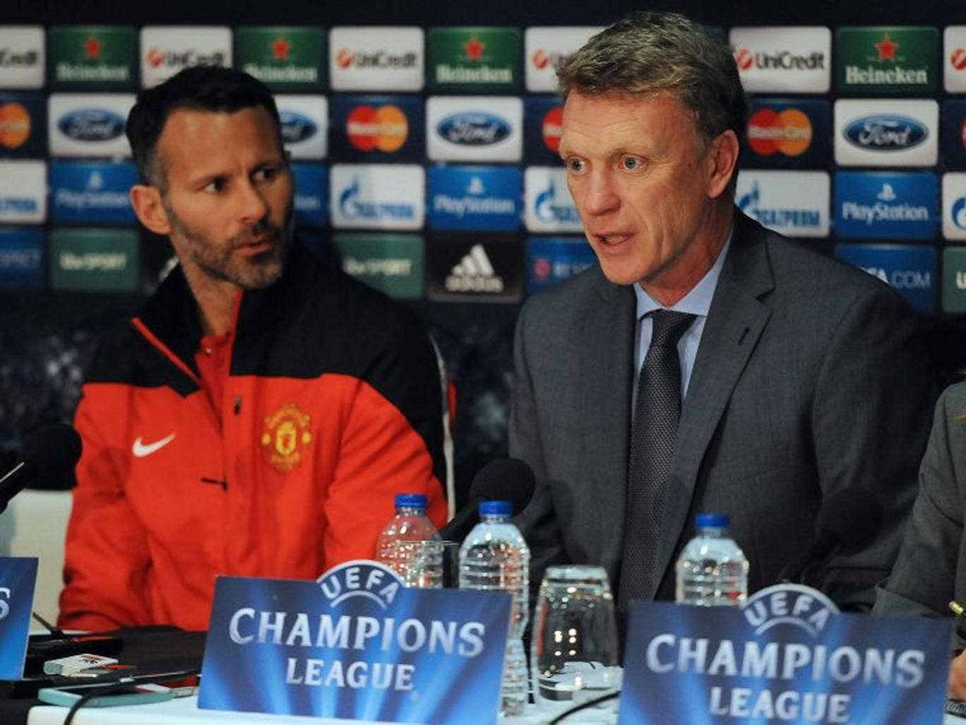 Ryan Giggs and David Moyes attempt to present a united front to the press yesterday