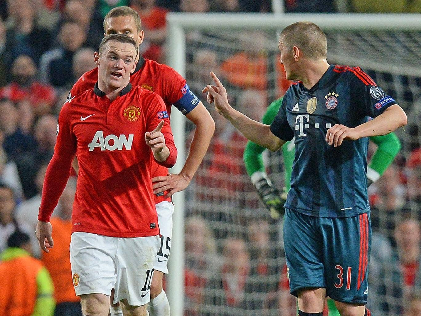 Wayne Rooney and Bastian Schweinsteiger wag fingers at one another following the German midfielder's sending off