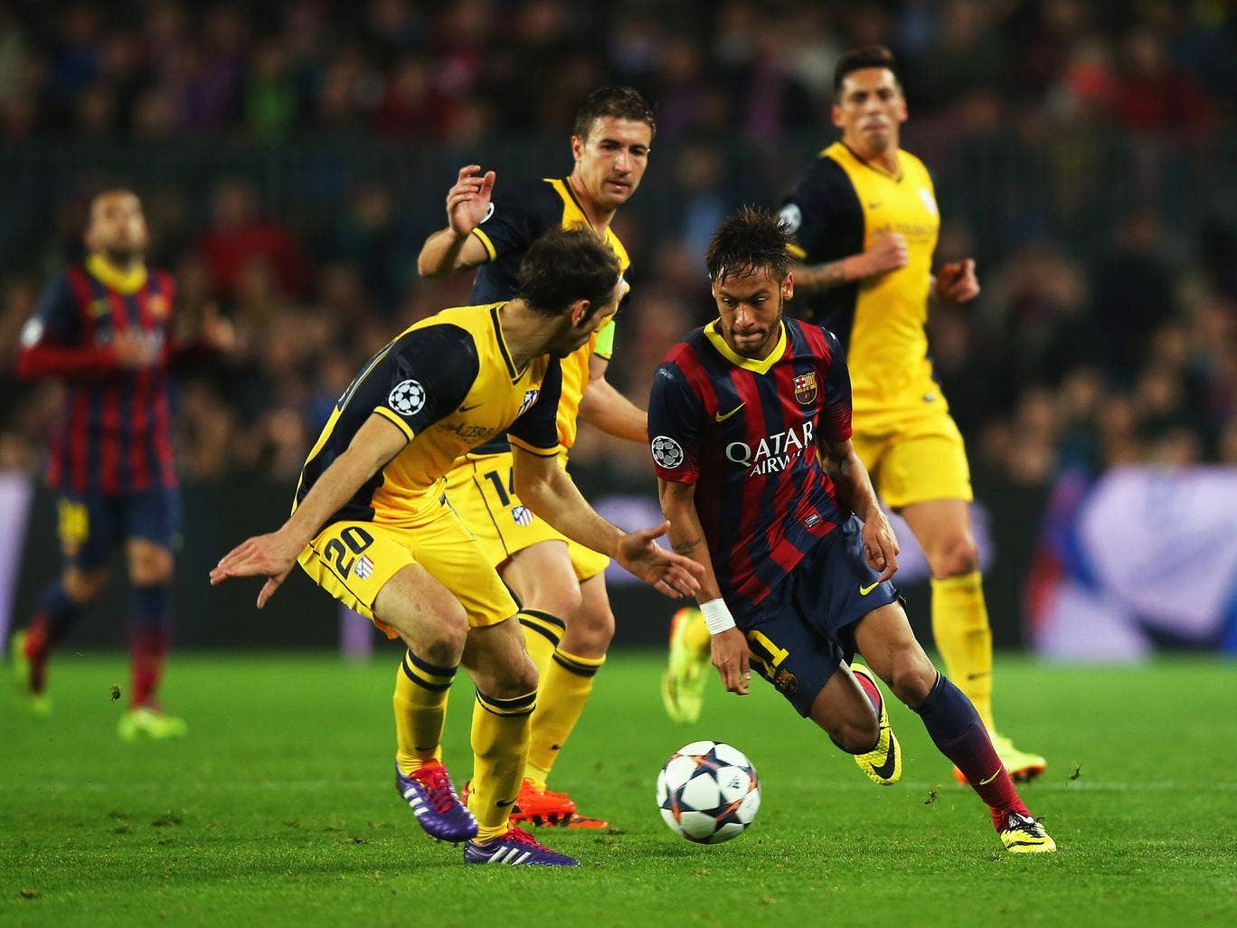 Neymar of Barcelona takes on Juanfran of Club Atletico de Madrid during the UEFA Champions League Quarter Final first leg