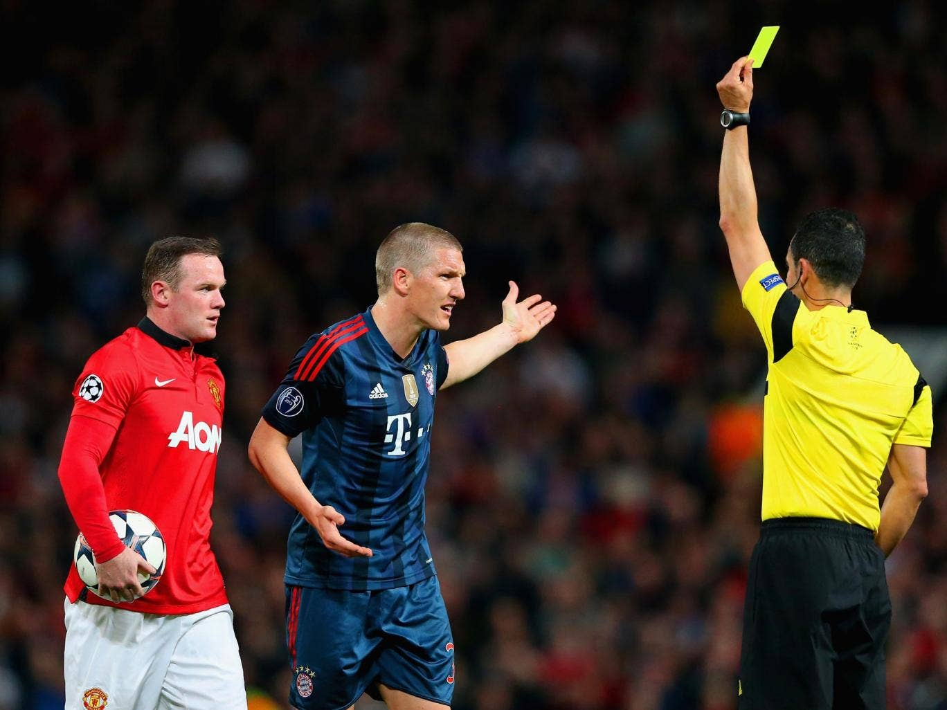 Bastian Schweinsteiger is shown a yellow card during the 1-1 draw between Manchester United and Bastian Schweinsteiger