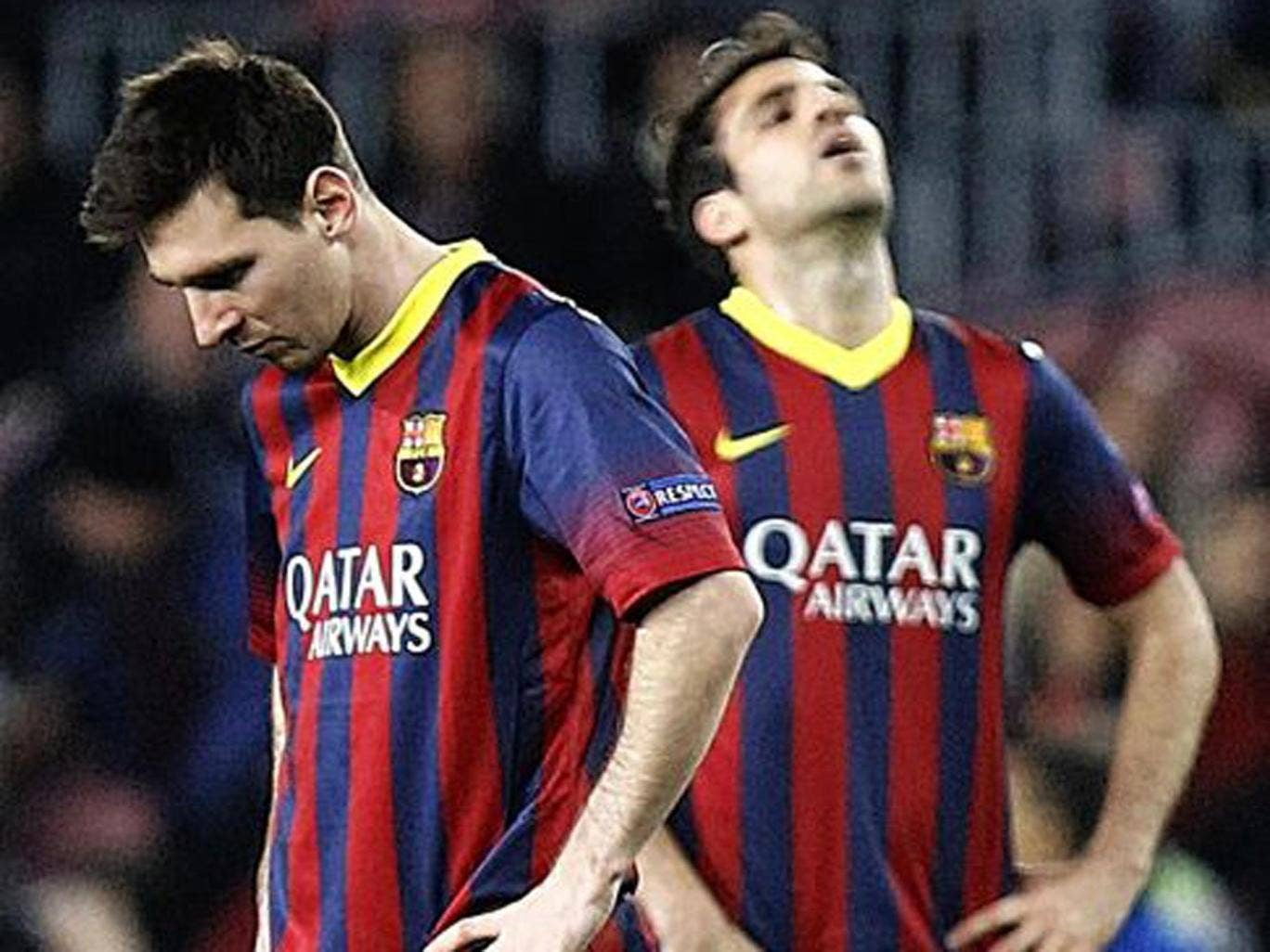 Lionel Messi and Cesc Fabregas hang their heads during Barcelona's draw against Atletico Madrid
