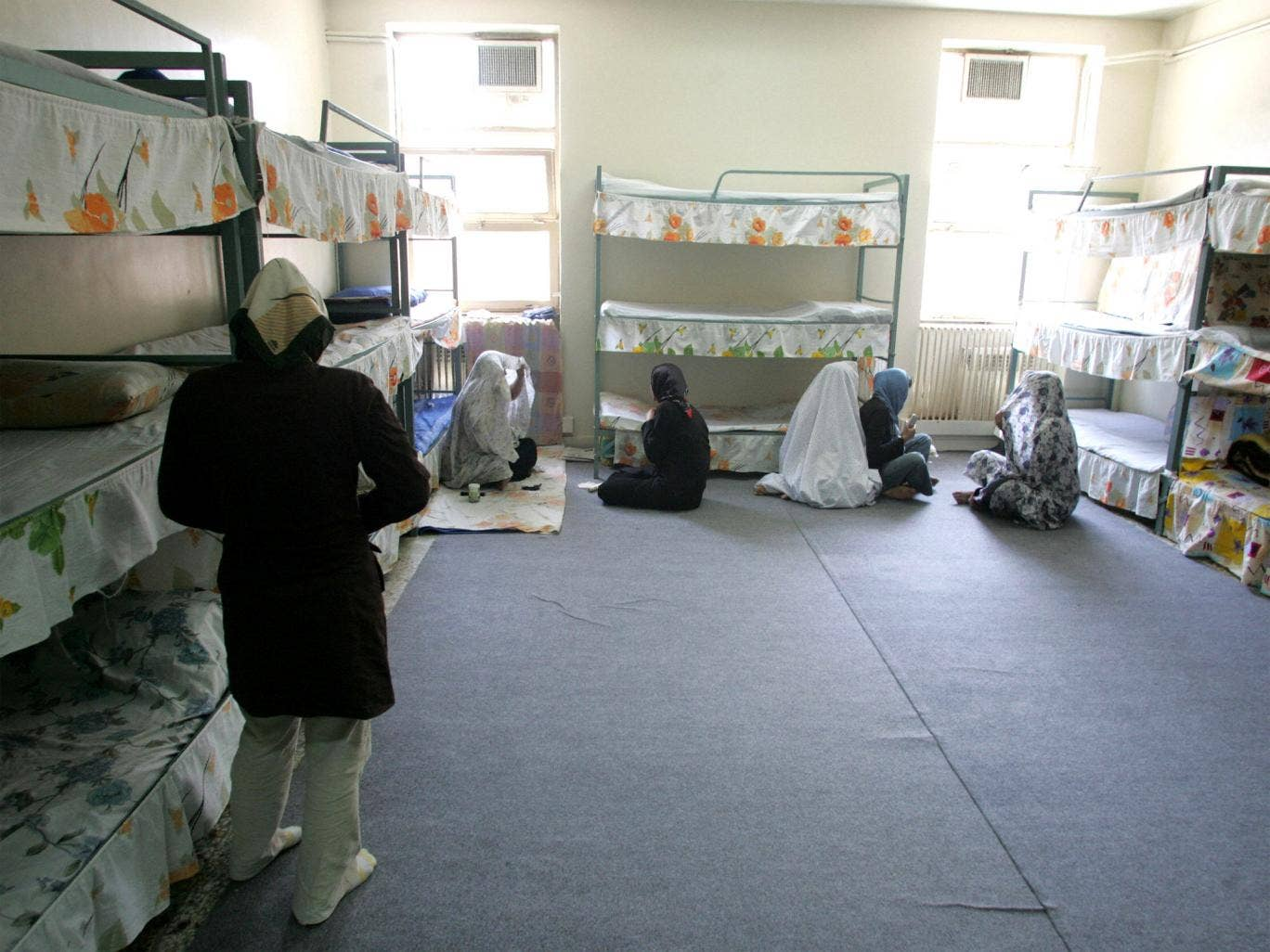 Iranian inmates in their cells at Evin jail
