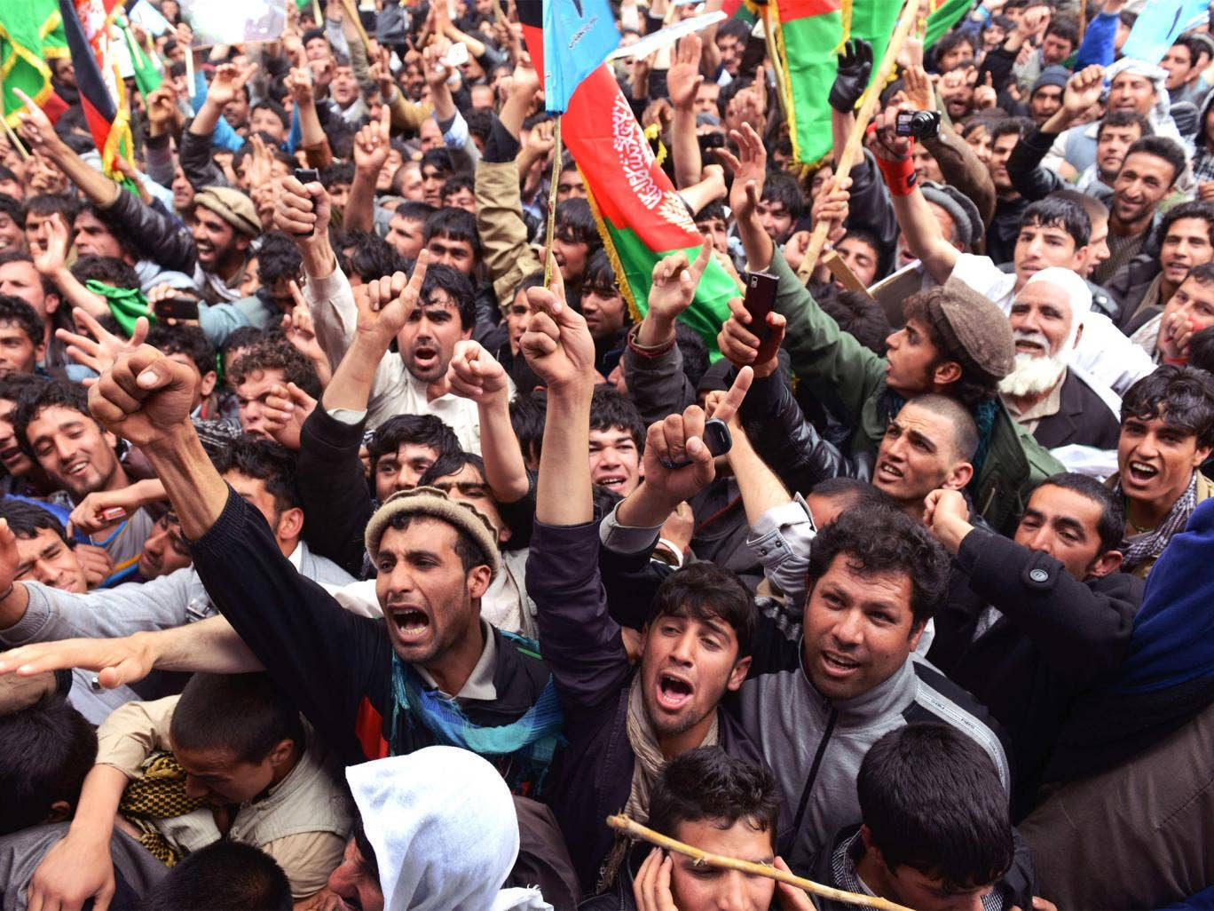 Supporters cheer presidential candidate Abdullah Abdullah during an election rally on the outskirts of Kabul