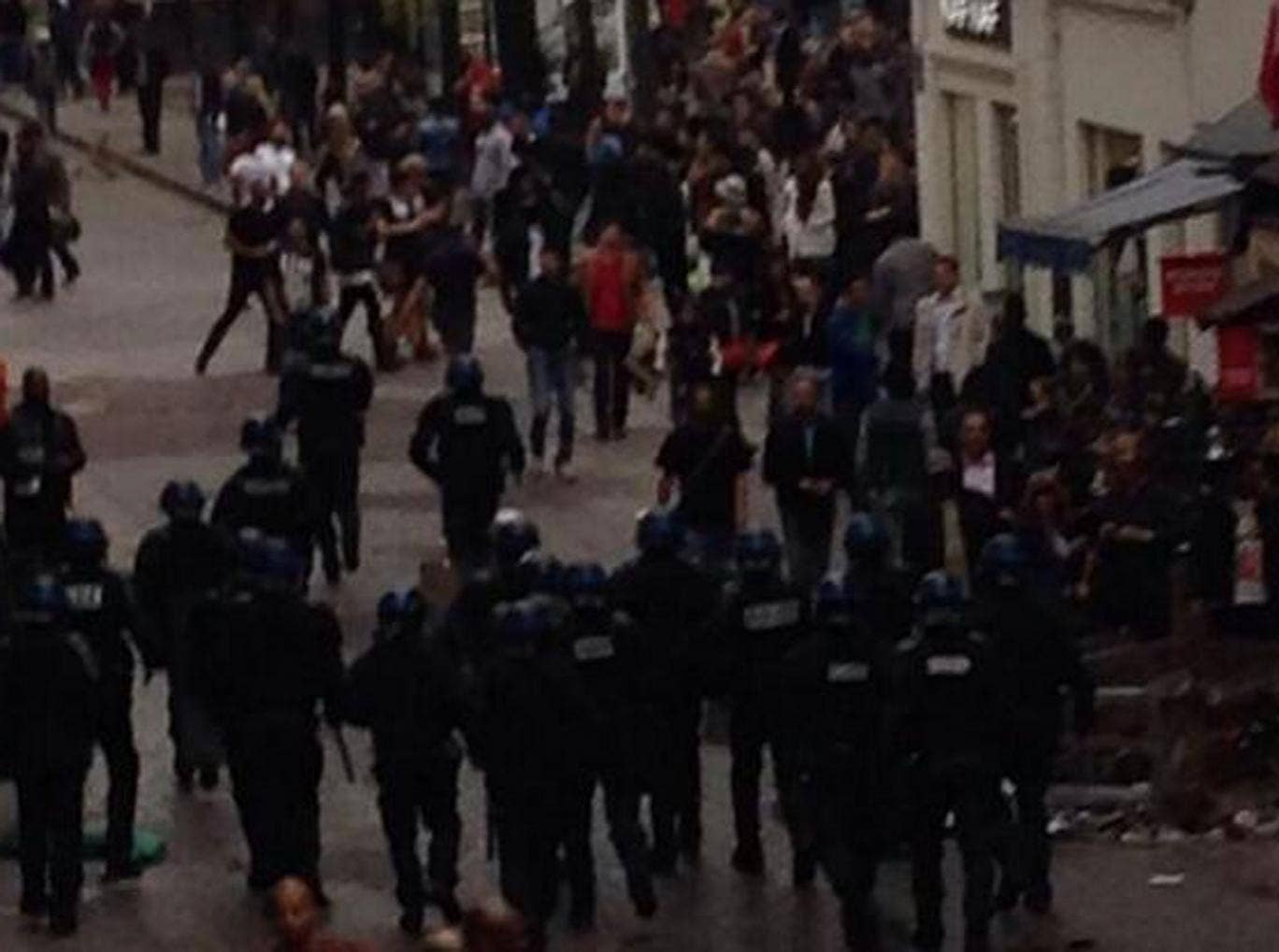 Police arrive at the scene in Paris on Wednesday afternoon