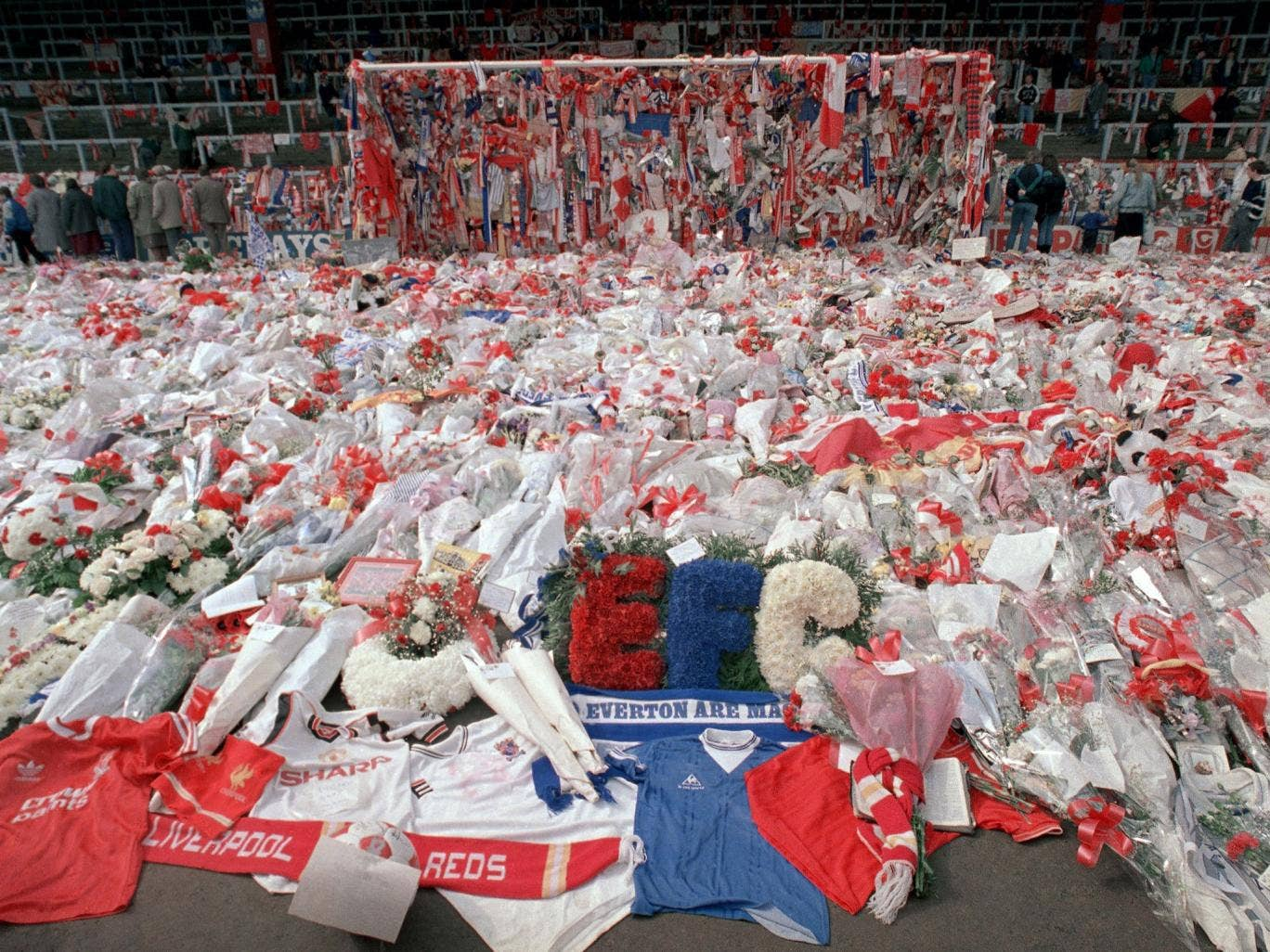 Floral tributes are placed by soccer fans at the 'Kop' end of Anfield Stadium in Liverpool on 17 April 1989 after the Hillsborough tragedy