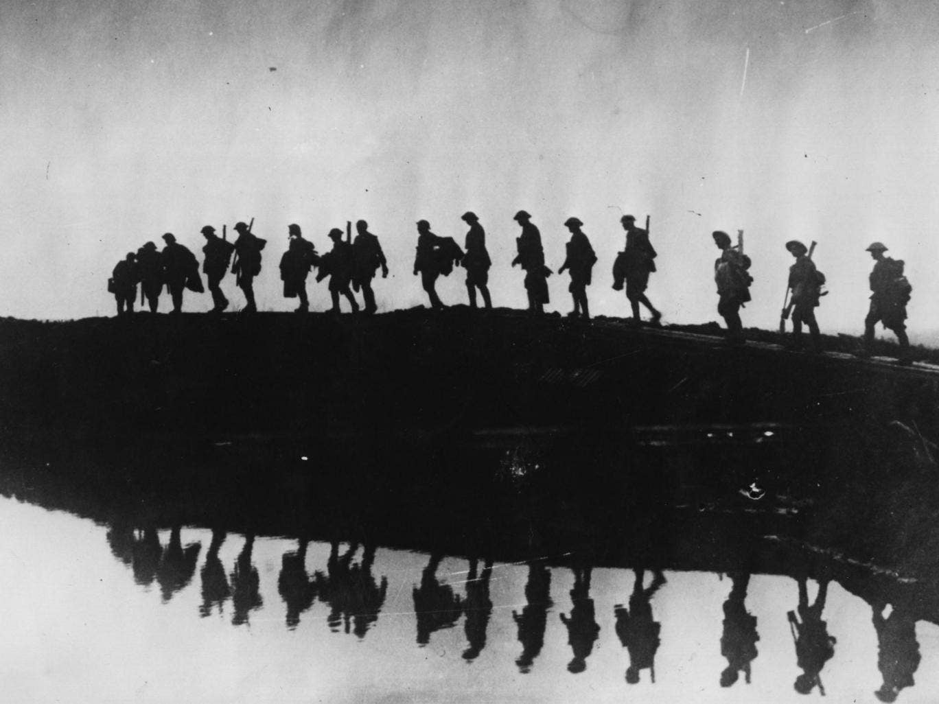 Supporting troops of the 1st Australian Division walking on a duckboard track near Hooge, in the Ypres Sector
