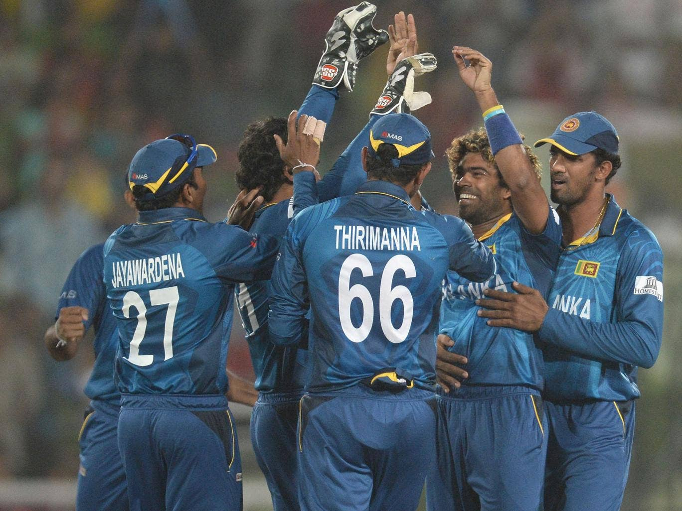 Lasith Malinga (second from right) celebrates the wicket of Chris Gayle