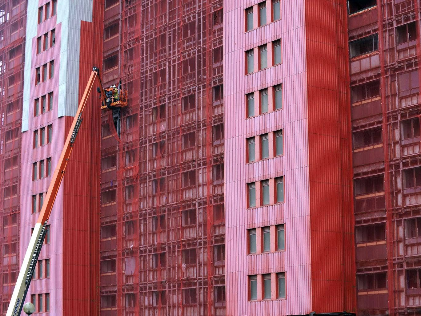 Workers inspect one of the 30-storey Red Road residential blocks in north Glasgow