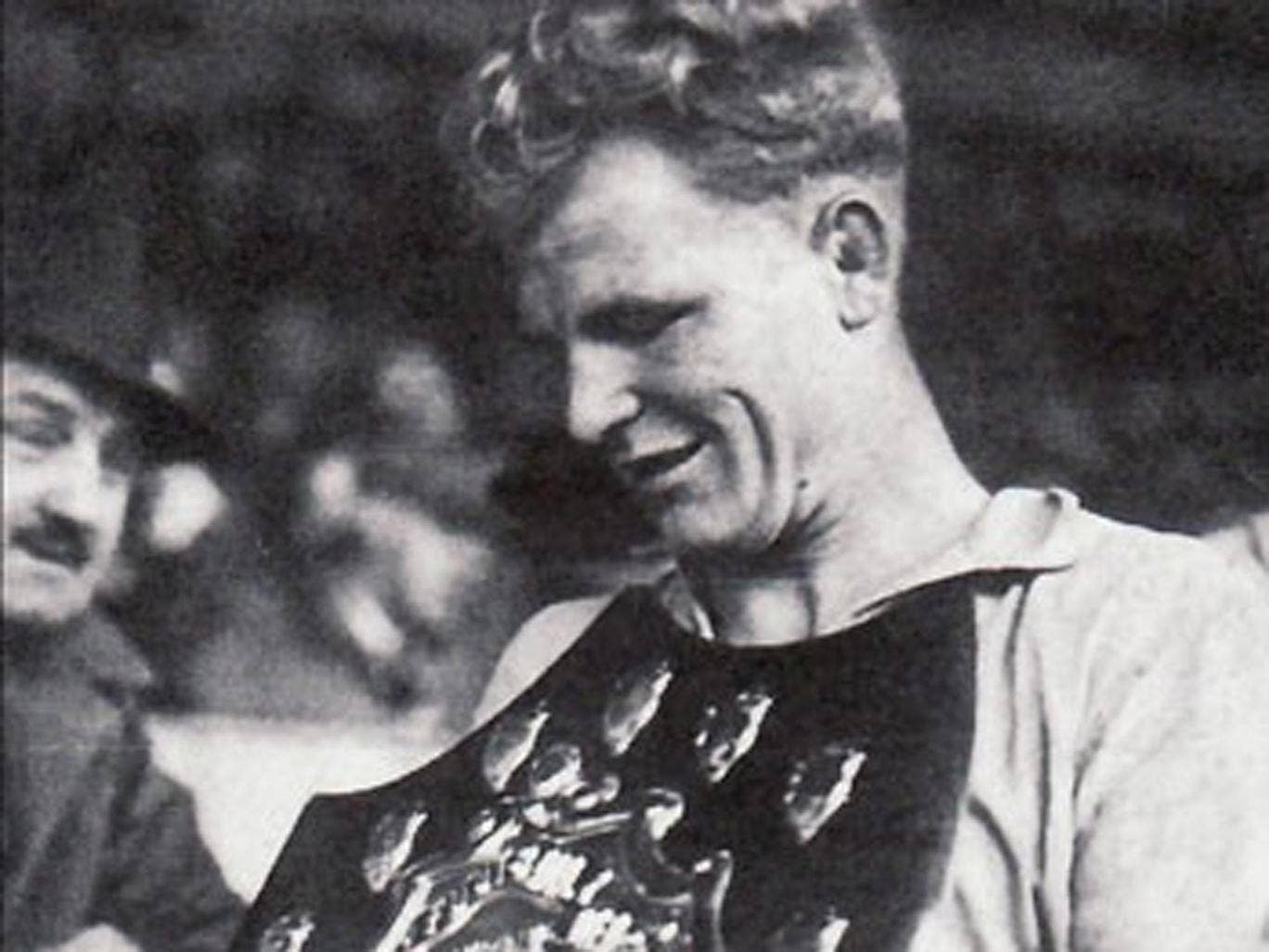 Fred Stansfield takes the trophy for Cardiff City's Third Division (South) title in 1947