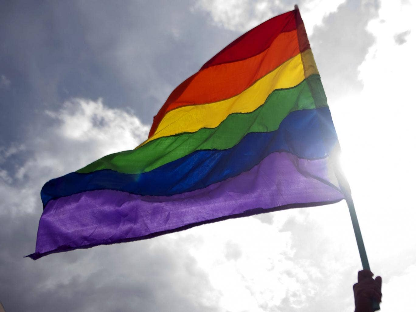 A reveller waves a rainbow flag during the Gay Pride Parade in Medellin, Antioquia department, Colombia on June 30, 2013.