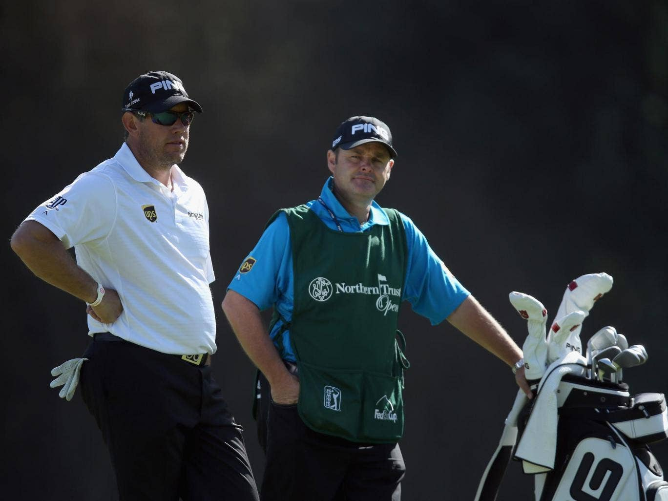 Caddie Billy Foster (right) on course with Lee Westwood