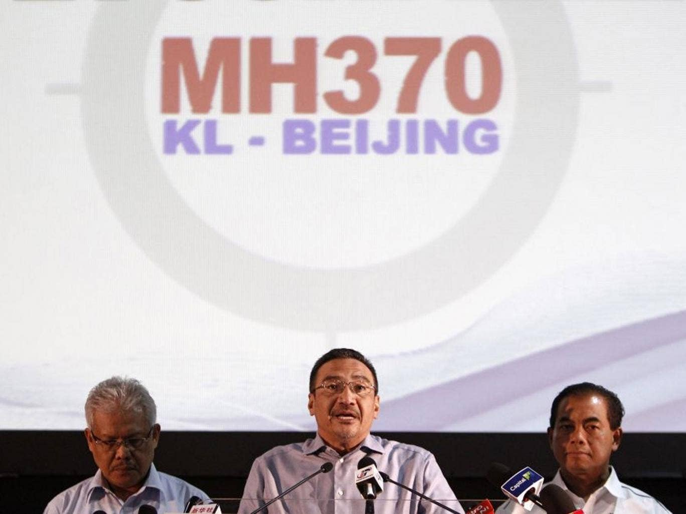 Malaysian acting Transport Minister Hishammuddin Hussein, center, speaks as Malaysian Deputy Foreign Minister Hamzah Zainuddin, left, and Malaysian Deputy Transport Minister Abdul Aziz Kaprawi listen during a press conference for the missing Malaysia Airl