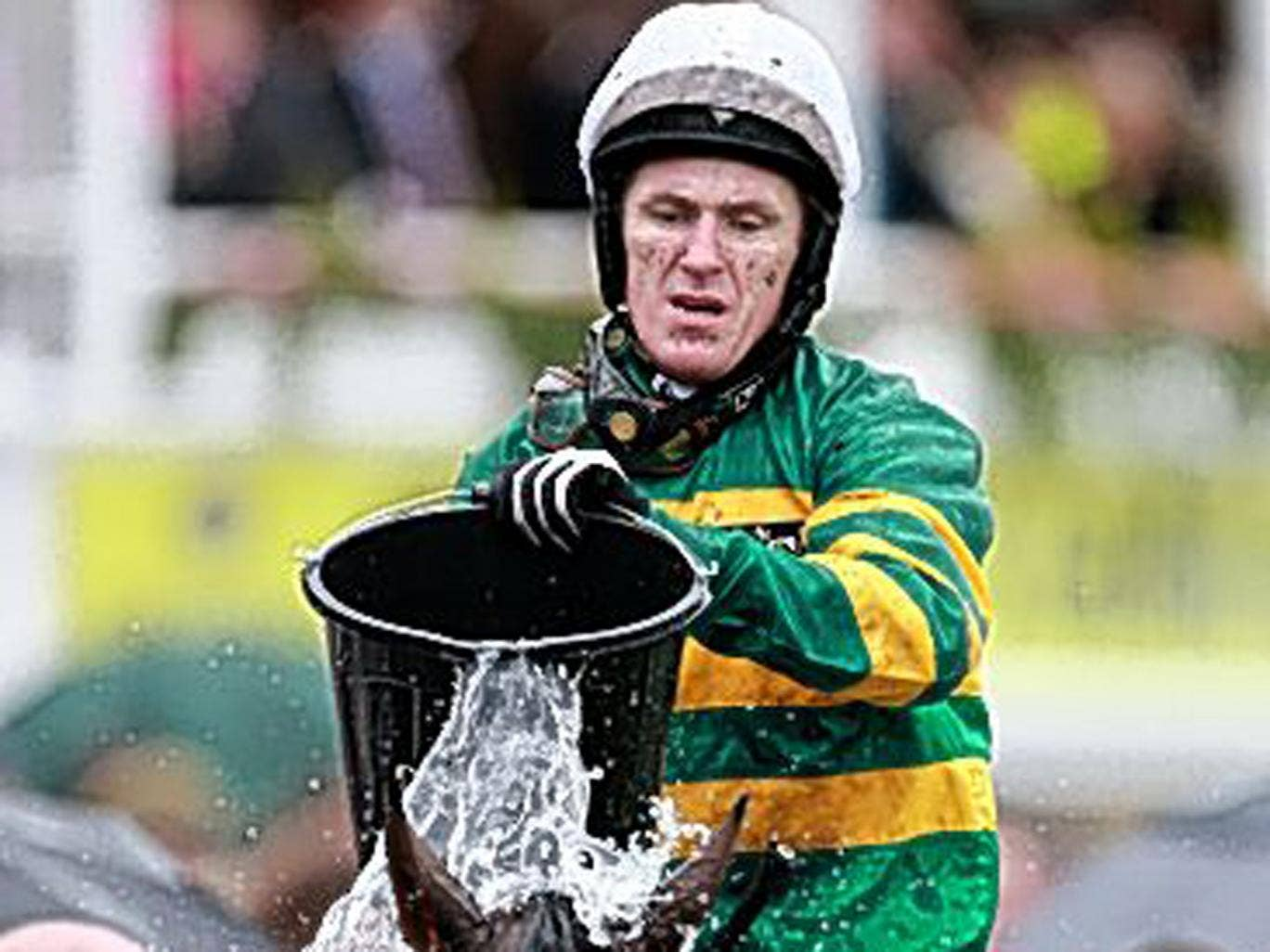 Making a splash: Tony McCoy cools off Double Seven after the race