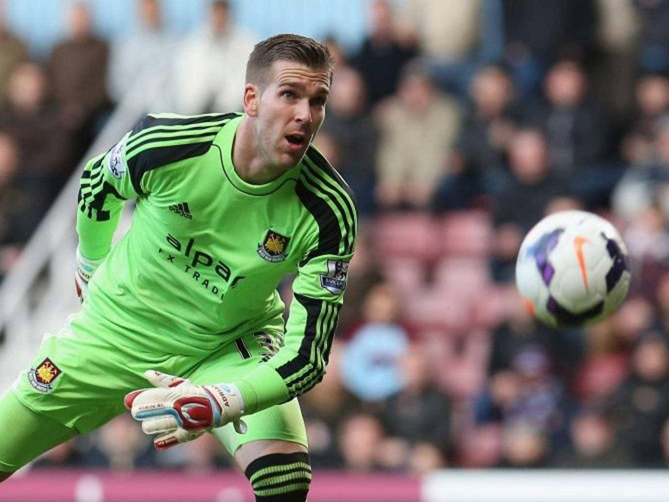 Adrian of West Ham United watches the ball loop over his head for Wayne Rooney's long range first goal