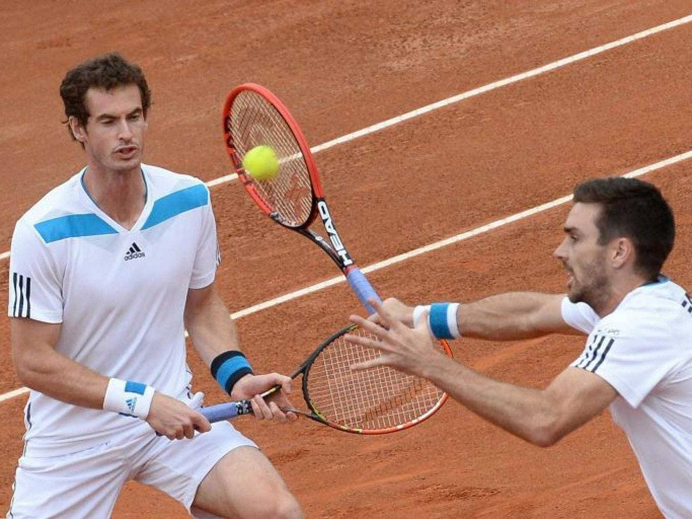 Lovely doubly: Andy Murray (left) and Colin Fleming on their way to a crucial Davis Cup victory for Britain in Italy