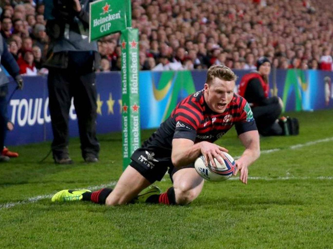 Double trouble: Saracens' Chris Ashton plunges over to score one of his two decisive tries