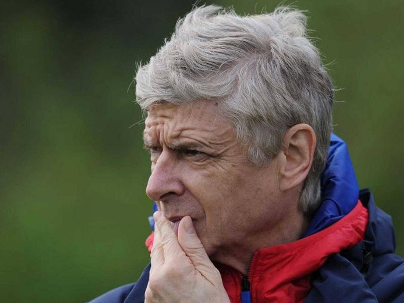 Wenger at a training session earlier this week: He has called for a review of the Premier League player loan system