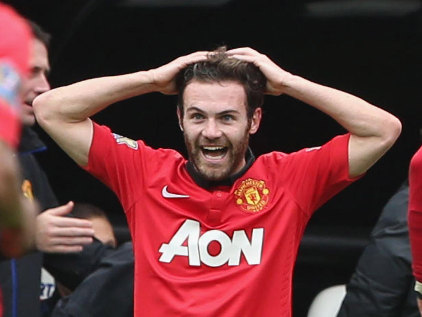 Juan Mata celebrates scoring for Manchester United in the 4-0 win over Newcastle