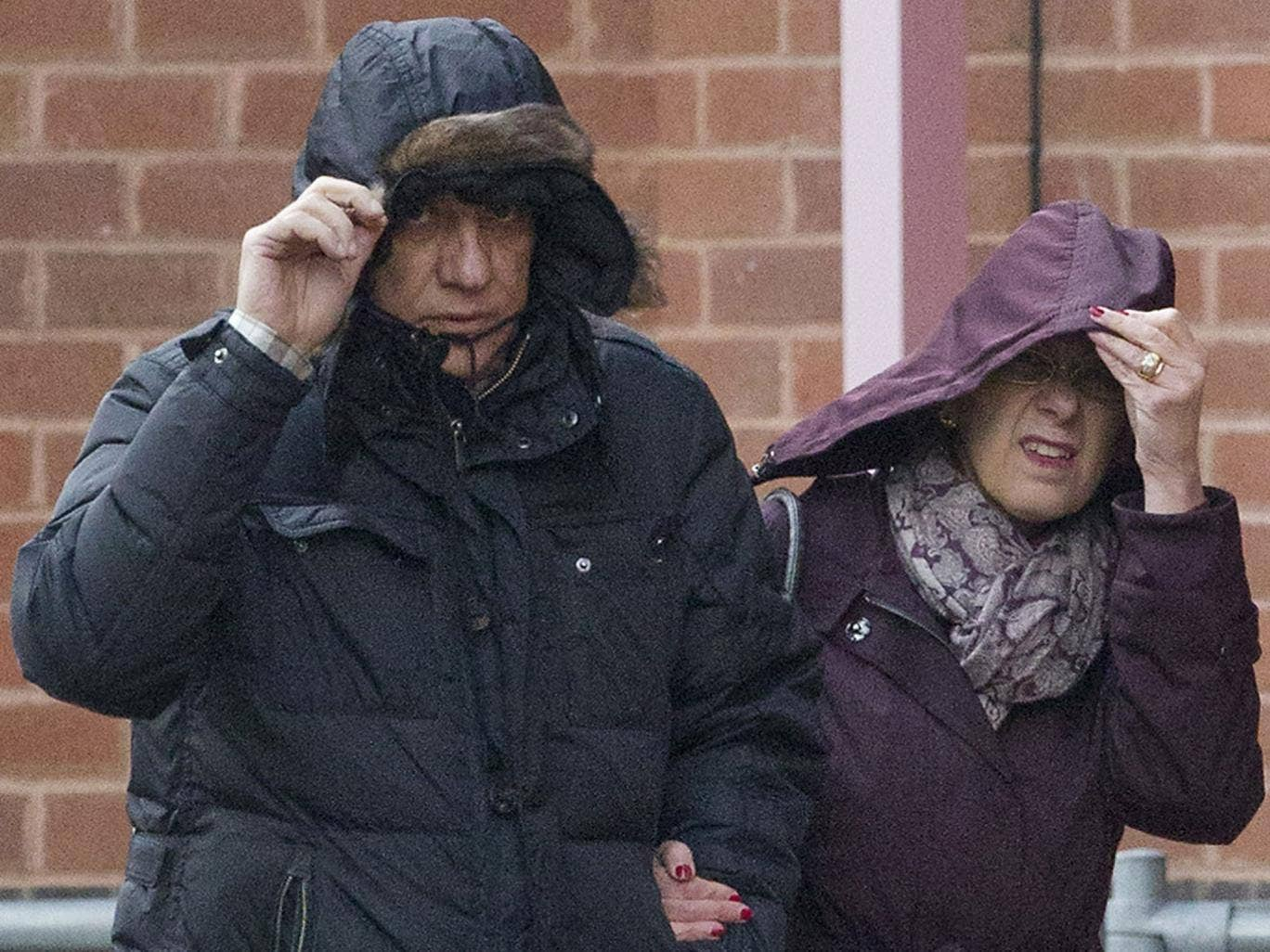 Convicted mafia boss Domenico Rancadore arrives with his wife Anne Skinner to report at Uxbridge Police Station in West London (18 March)