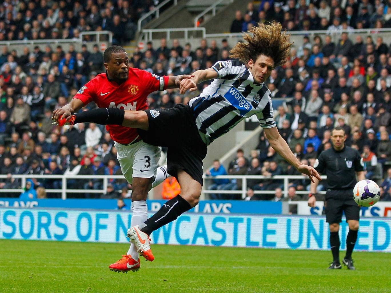 Patrice Evra of Manchester United and Newcastle's Fabrizio Coloccini contest possession