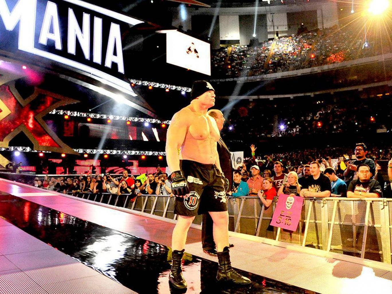 Brock Lesnar heads to the ring for his showdown with The Undertaker, accompanied by Paul Heyman