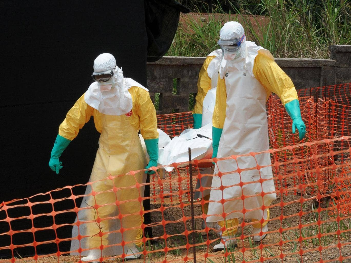 Staff of the 'Doctors without Borders' ('Medecin sans frontieres') carry the body of a person killed by viral haemorrhagic fever