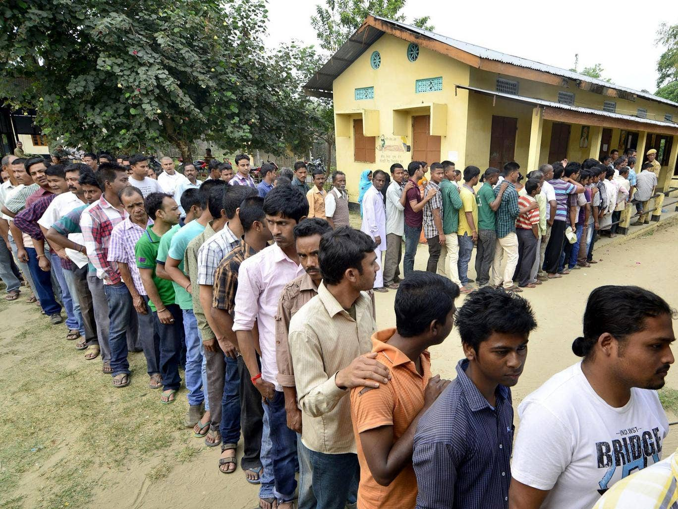 Villagers wait in line to cast their votes during the first phase of the Indian general election yesterday. India's five-week, multi-phase parliamentary elections began with voting in Tripura and Assam