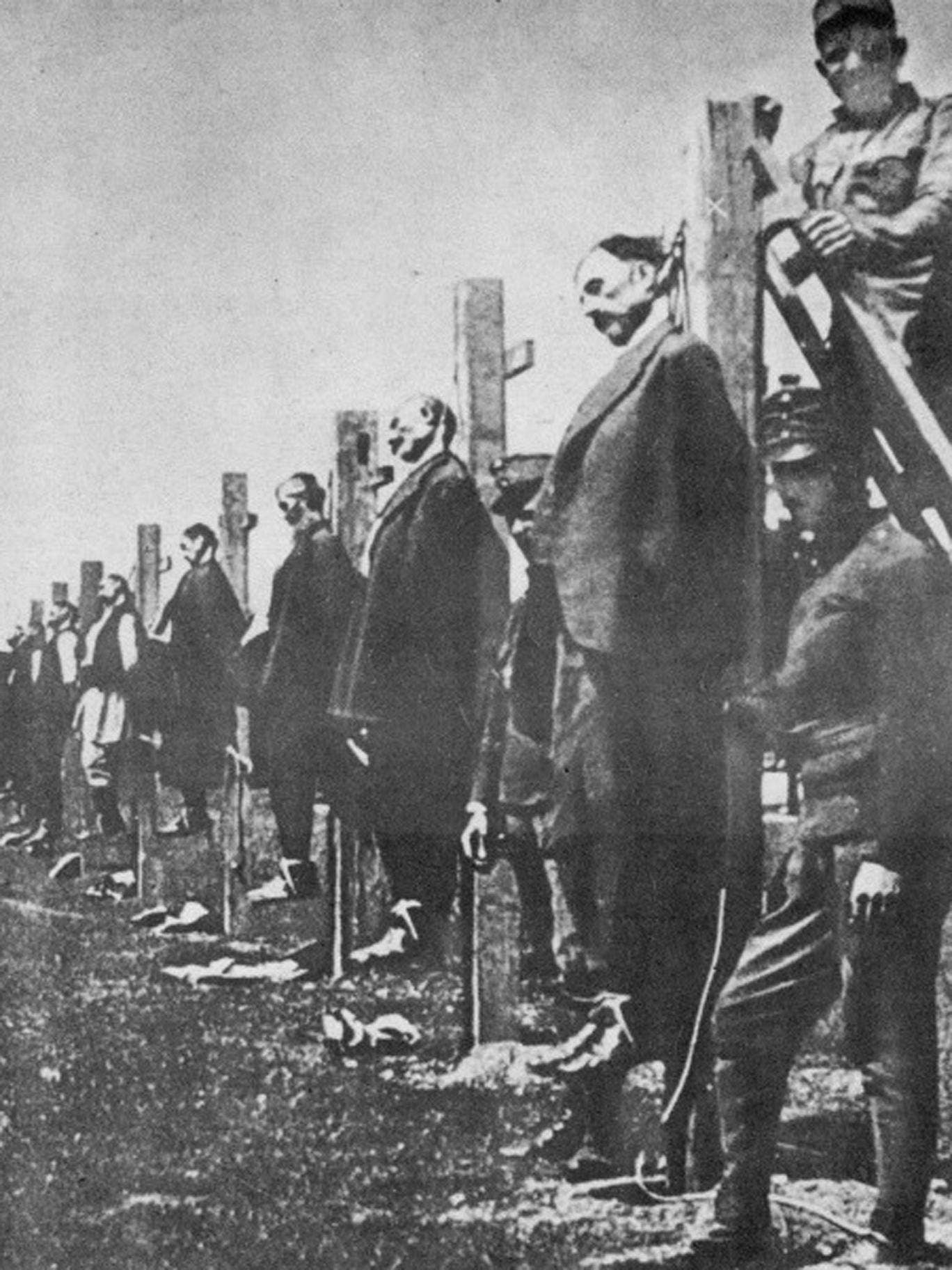 Civilians near the Austrian lines in Serbia are strung up – probably as a reprisal for guerrilla resistance to the invaders