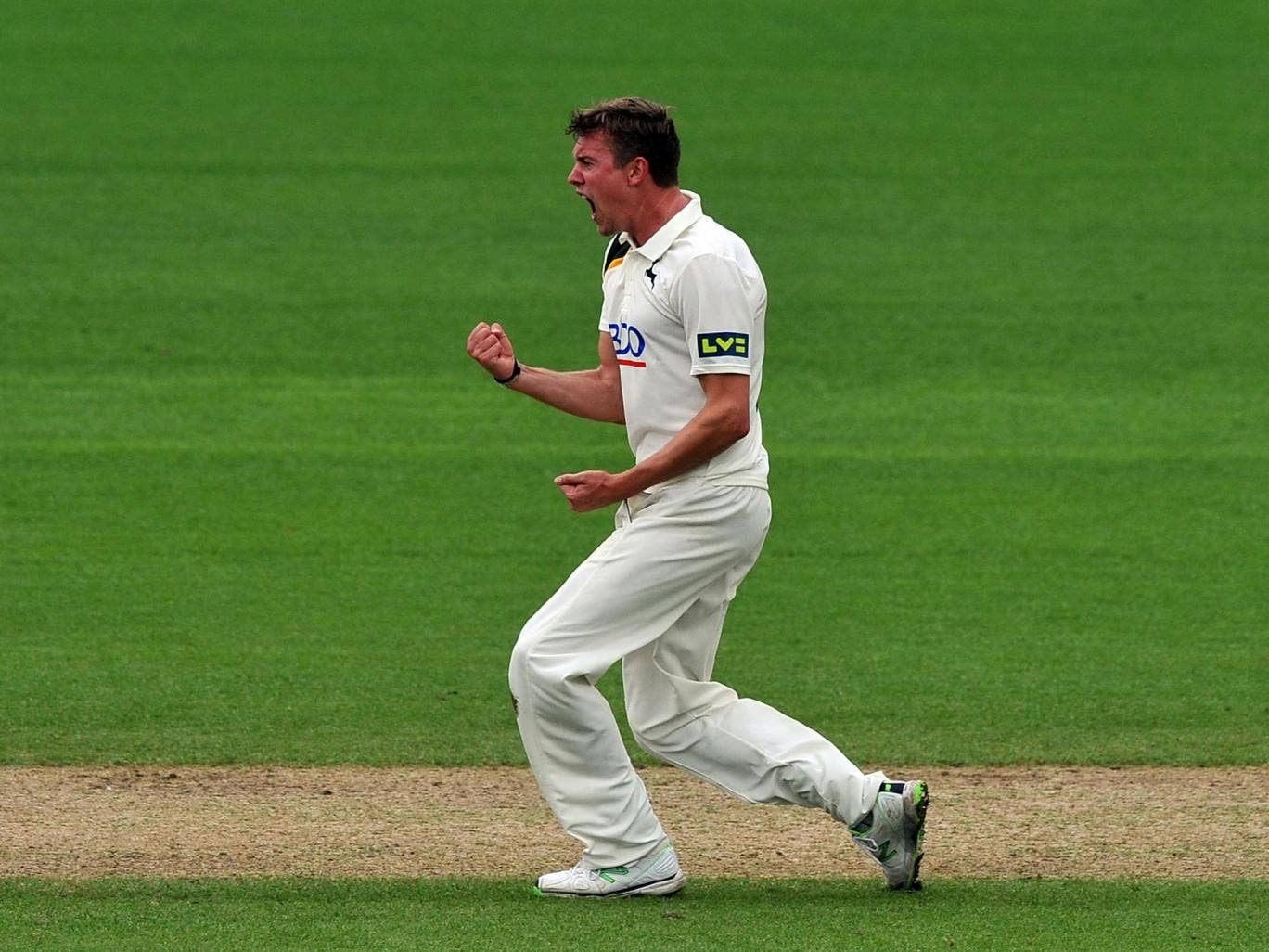 Nottinghamshire's Jake Ball celebrates taking the wicket of Lancashire's Luke Procter