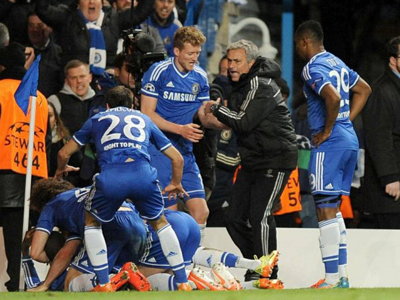 Jose Mourinho (second from right) celebrates with his players after Demba Ba (bottom left) scored the crucial second goal in the 2-0 win over PSG