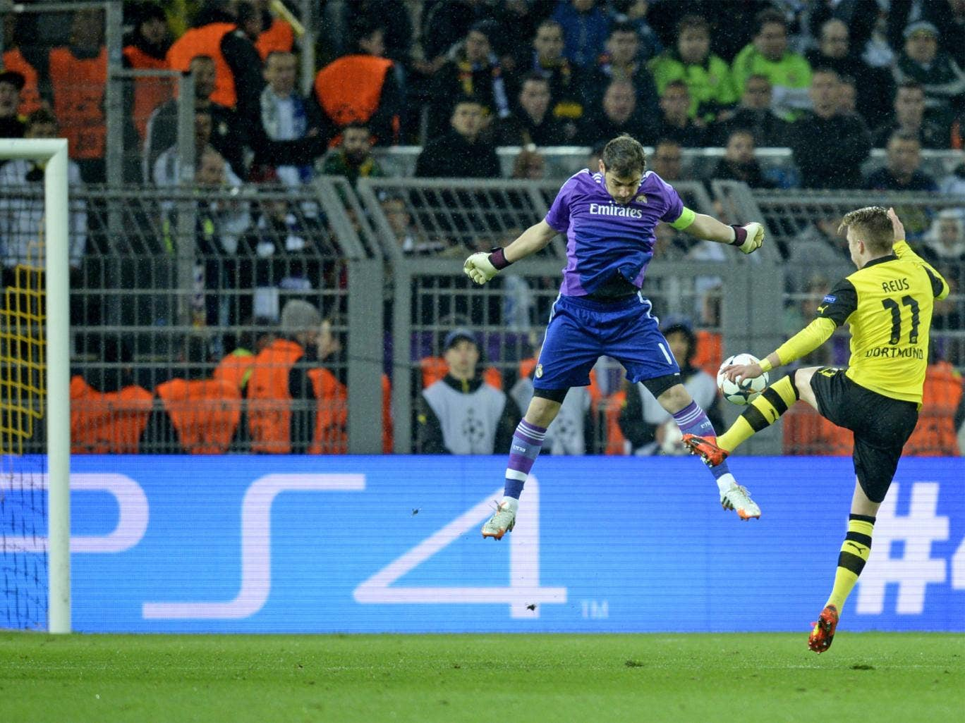 Marco Reus rounds an exposed Iker Casilas to give Dortmund the lead and hope of overturning the tie