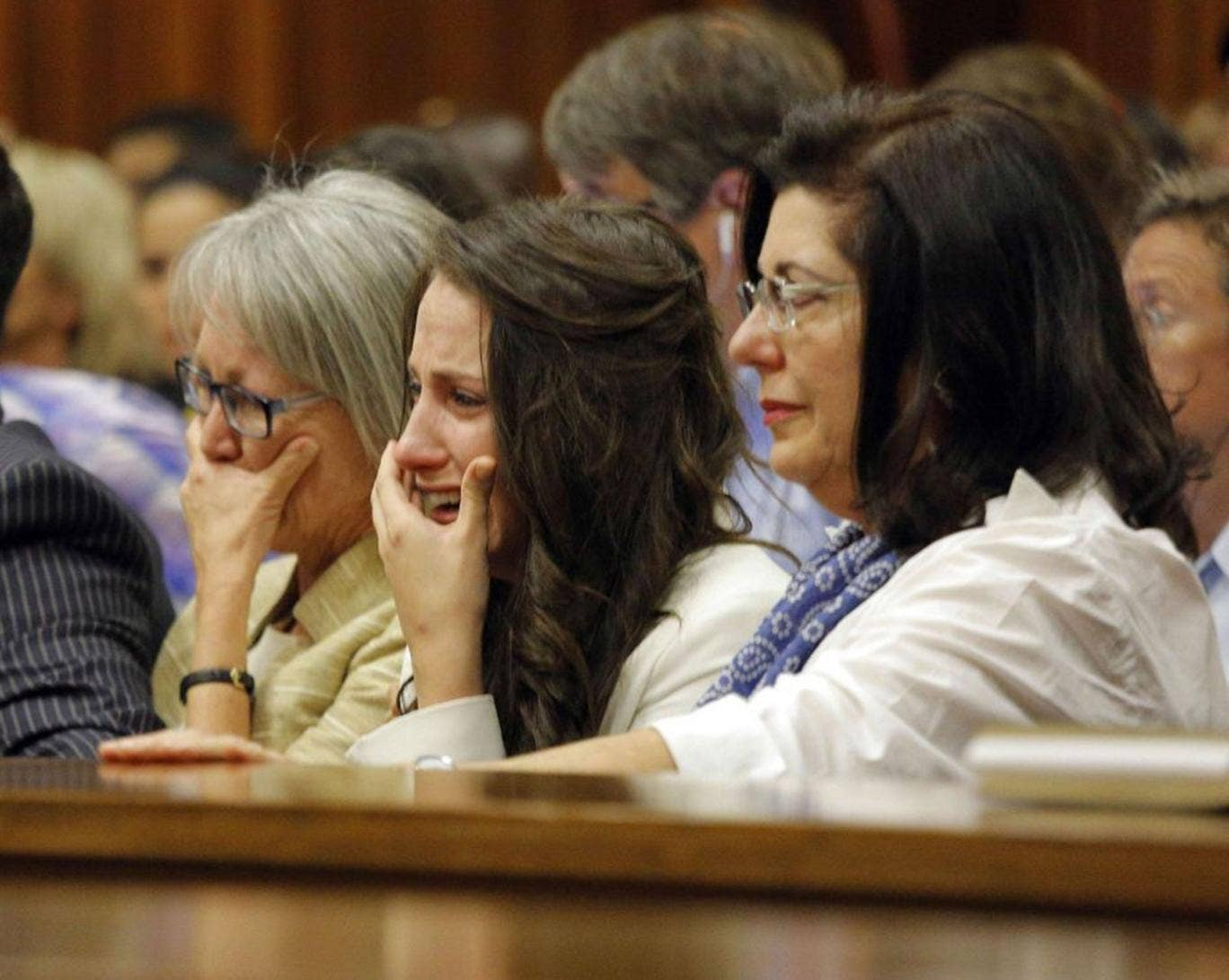 Aimee Pistorius (second right), Oscar's sister, cries as the athlete gives evidence