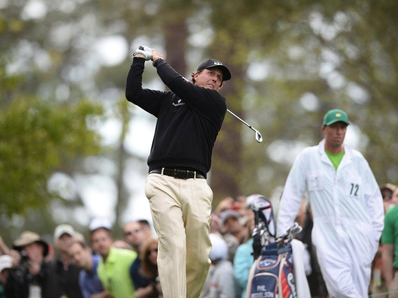 Phil Mickelson practices at Augusta National ahead of the 2014 Masters