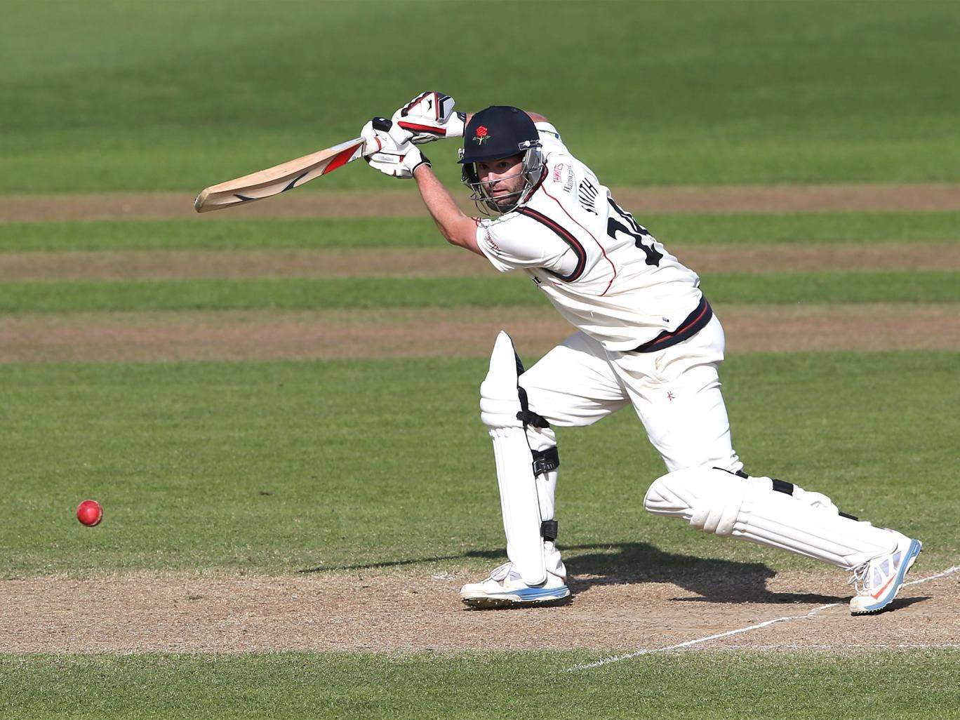 Tom Smith scored 76 and took five wickets for Lancashire but could not prevent a Notts victo