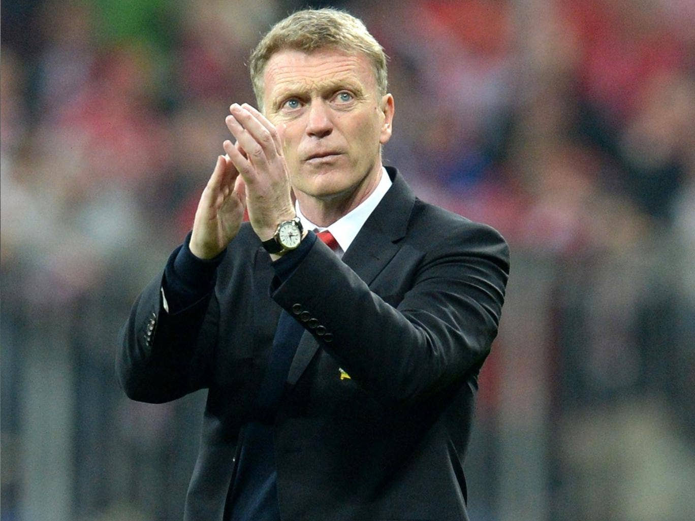 David Moyes applauds the travelling United support following their elimination from Europe