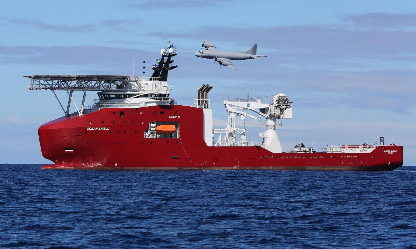 A Royal Australian Air Force AP-3C Orion flying past Australian Defence Vessel Ocean Shield, released by the search authorities on 9 April