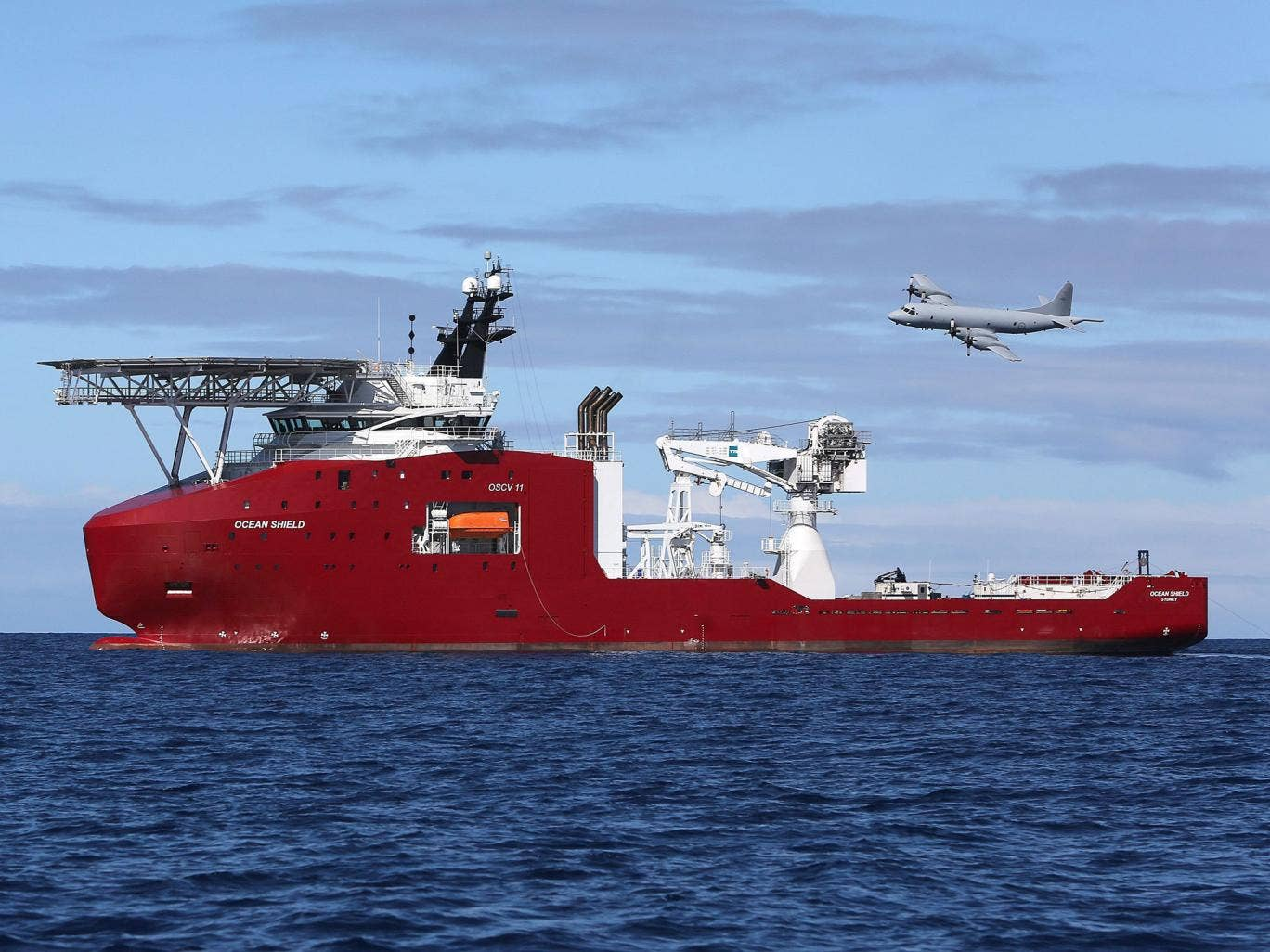 A Royal Australian Air Force AP-3C Orion fly past the Australian Defence Vessel Ocean Shield on a mission to drop sonar buoys to assist in the acoustic search in support of Operation Southern Indian Ocean